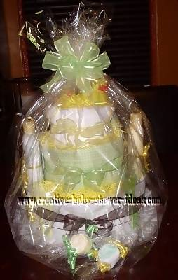 green and brown rubber ducky diaper cake