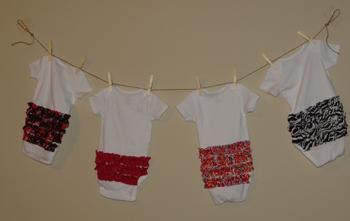ruffle bum onesies on a clothesline