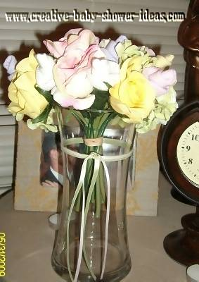 side view of sock rose bouquet in a vase