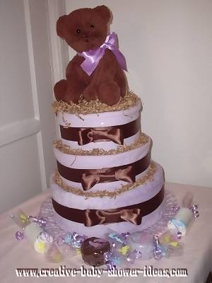 purple and brown teddy bear diaper cake