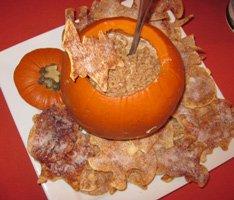 caramel toffee dip in pumpkin with bat chips