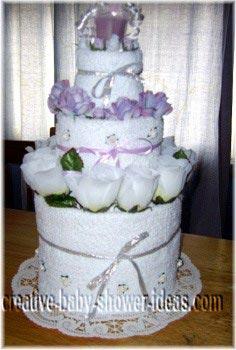 white and lavendar towel cake