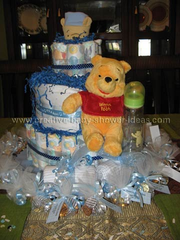blue winnie the pooh diaper cake with paper shred