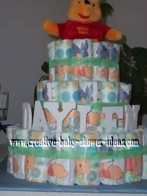 closeup colorful diapers winnie the pooh diaper cake