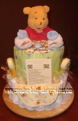 pastel winnie the pooh diaper cake with poem